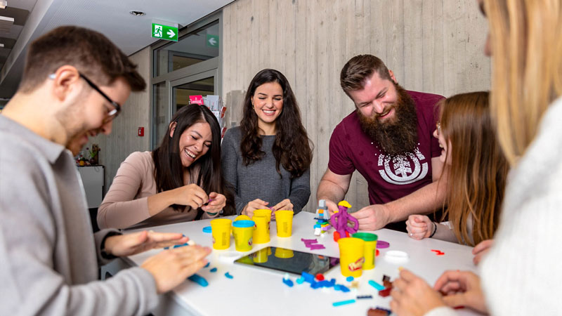 imc employees facing new challenges by playing with playdough