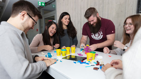 imc employees playing with playdough