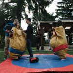 imc employees in sumo suits