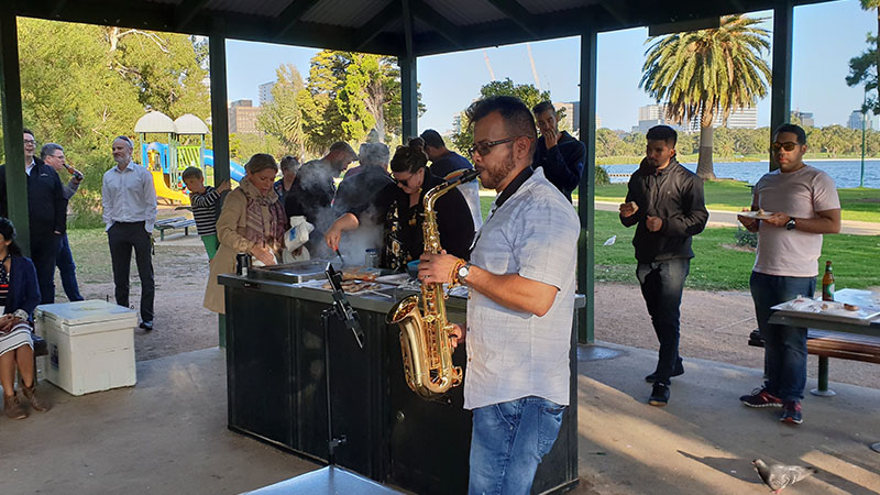 bbq at melbourne office with employee playing saxaphone