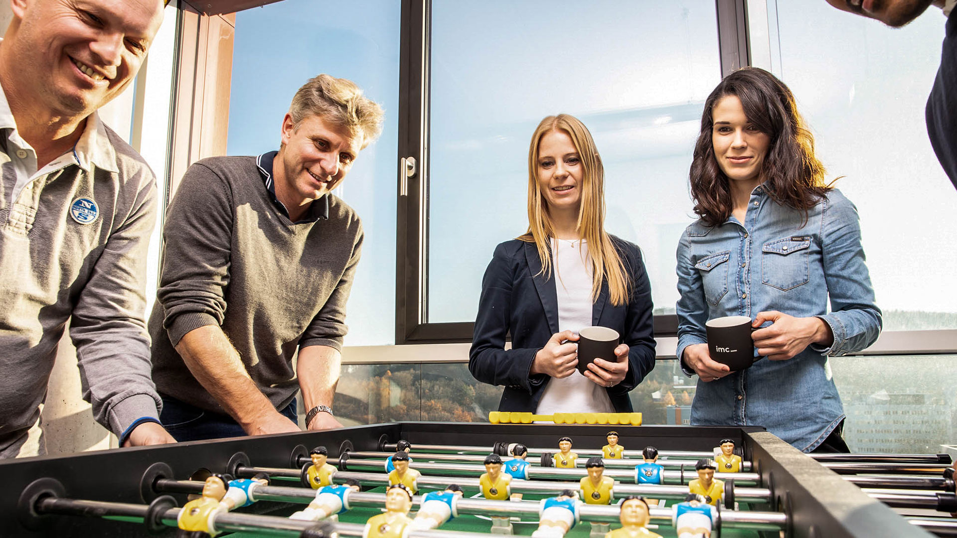 imc employees playing table football