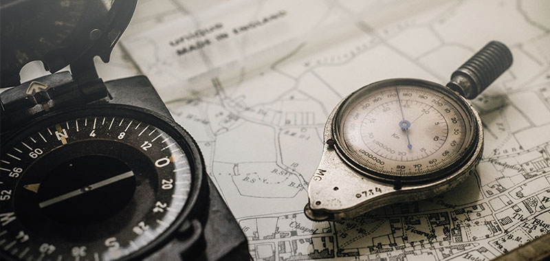 photo of compass on a map