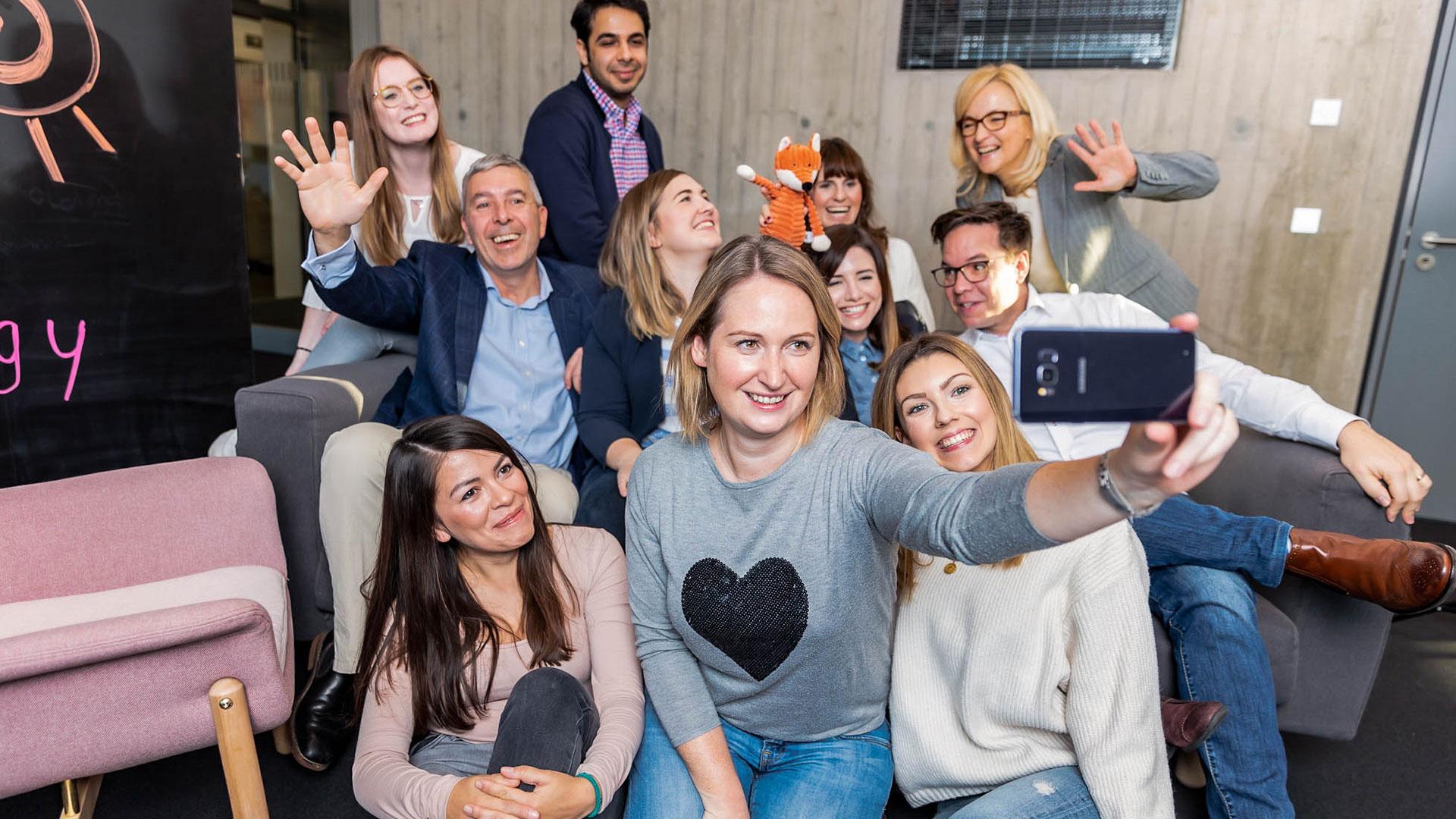 imc employees gather to take a selfie