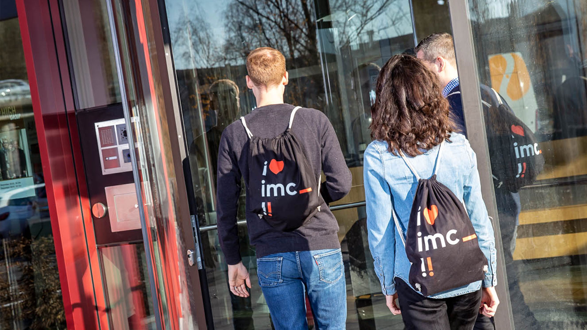 image of new employees entering imc office tower